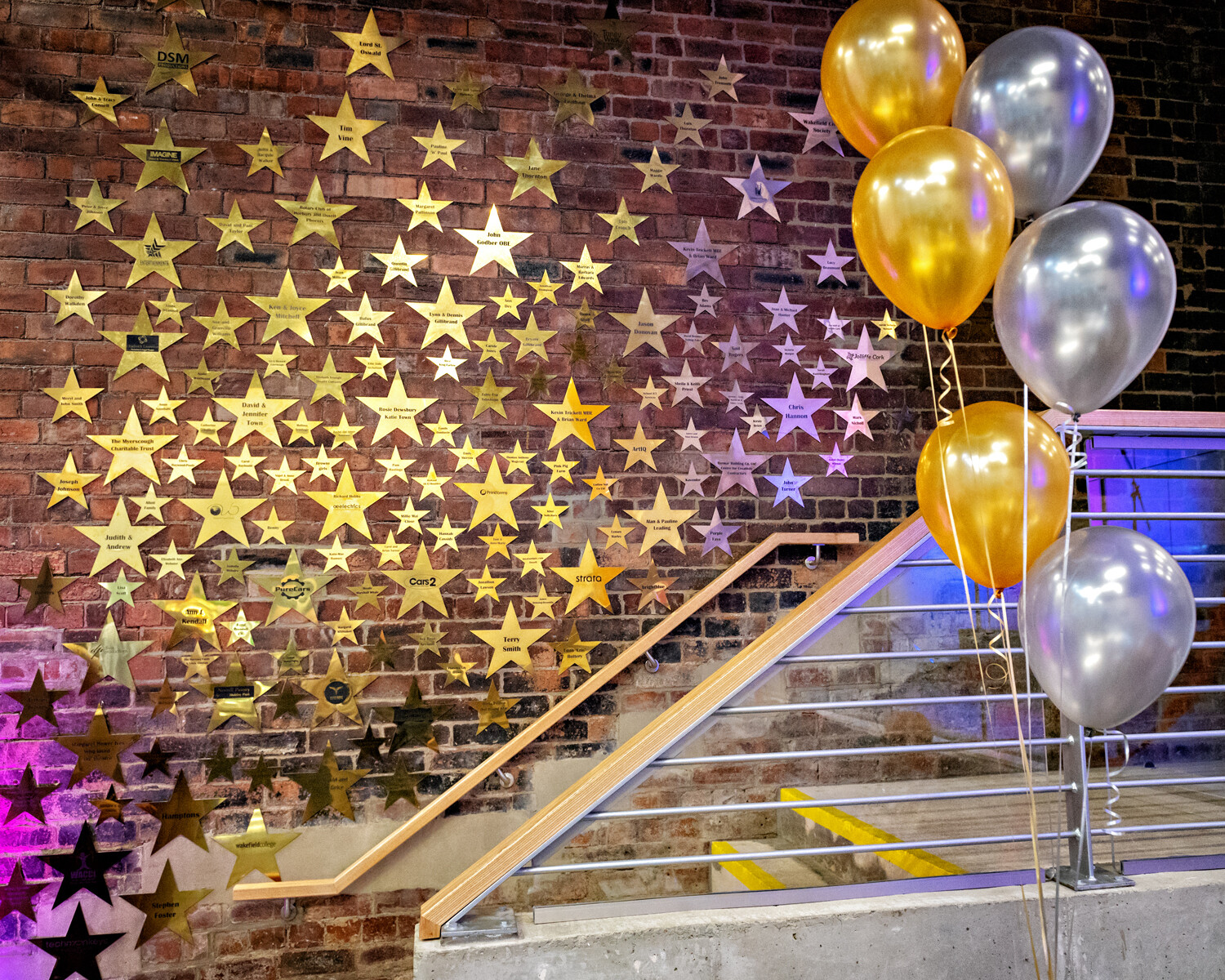 Theatre Royal Wakefield's wall of fame, hundreds of gold metal stars on a brick wall